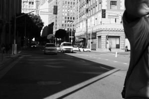 Black and White photo of man on a bicycle passing by